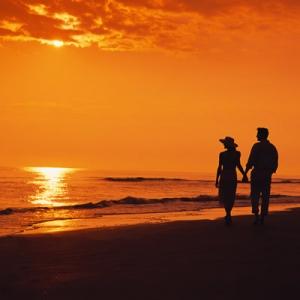 Couple walking at sunset